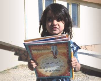 Girl in Afghanistan with a pile of Hoopoe books