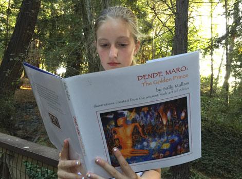 Girl reading the book Dende Maro