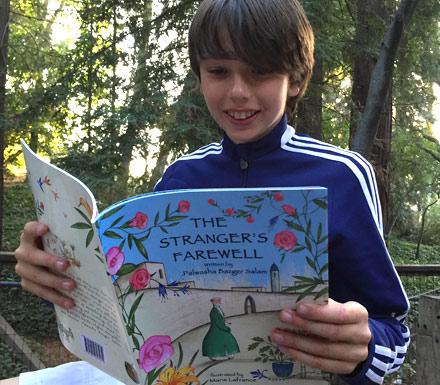 Boy reading the book The Stranger's Farewell