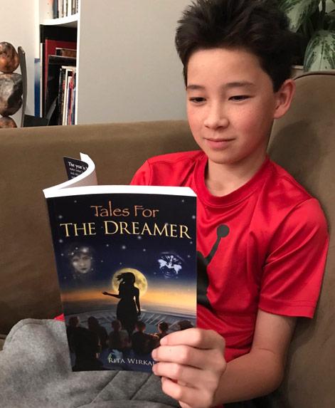 Child reading The Dreamer