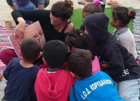 Kids gathered around a reading of Neem the Half-Boy